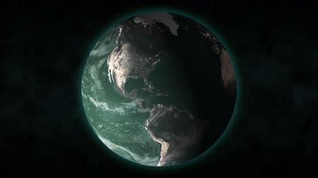 atmosphere : From outer space, the camera pushes in on Earth as it rotates with a greenish tint.  Stock Footage