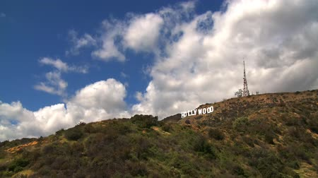 blockbuster : Time lapse clouds billowing over the Hollywood sign.