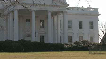 west wing : Looking across the North Lawn from Pennsylvania Avenue at the White House in Washington, D.C. The camera zooms in closer to the house. Stock Footage