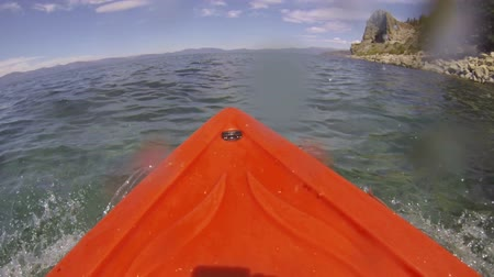 kano : A kayak point of view (POV) rowing on the Nevada side of Lake Tahoe as water splashes on and drips down the lens. Stok Video
