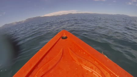 kano : A kayak point of view (POV) rowing through the open water on the Nevada side of Lake Tahoe. Stok Video