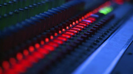 dengeleme : Floating close up on the button controls of a professional sound mixing board.