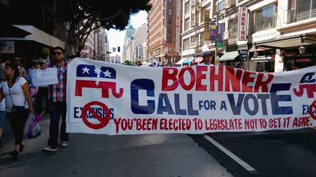 illegal alien : Boehner Call for a Vote Banner Marching. During an immigration rally in downtown Los Angeles on September 22 2013 some protesters carry a banner that reads BOEHNER CALL FOR A VOTE: Youve been elected to legislate not to set it aside. Referring to Rep
