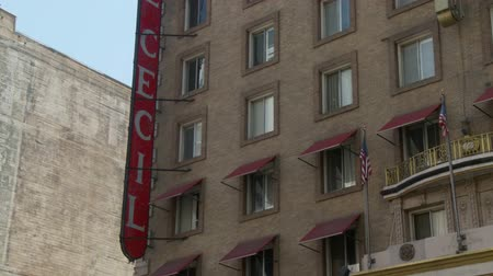 hooker : Cecil Hotel Sign. The camera tilts down and then up to see the vertical Cecil Hotel sign hanging on the building. Built in the 1920s, the Cecil Hotel in Downtown Los Angeles has become known for criminal activity including serveral murders, suicides, an Stock Footage