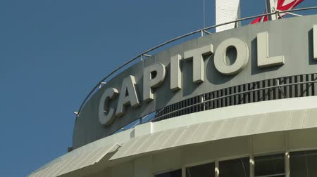 ostor : Capitol Records Whip Pan. Whip pan across the letters Capitol Records at the top of the world famous Capitol Records building in Hollywood, California.