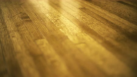 баскетбол : Vintage Hardwood Floor, Angled. Close angle moving across clean and shiny hardwood as reflections gleam across the floor.