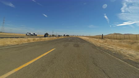 deteriorated : Rural Road Hyperlapse. A hyper-lapse of a vehicle POV as it drives down an old and run-down road in the rural countryside outside of Los Banos, California.