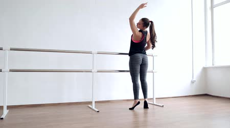 стремление : A young girl is an aspiring dancer. Girl ballerina with lush hips performs ballet exercises in the Studio.