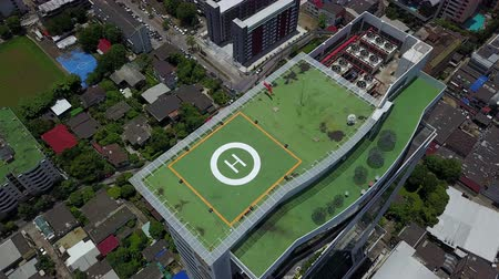 heliport : 4K Helicopter landing to helipad on the roof