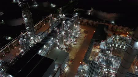 4K Night aerial view around oil refinery plant