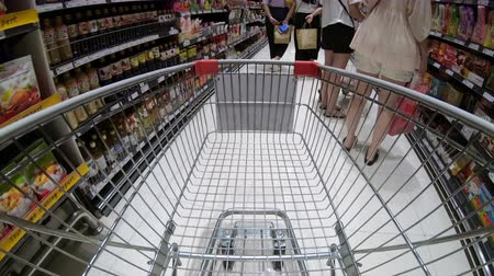 grocery : 4K Time lapse clip of shopping cart going around grocery store