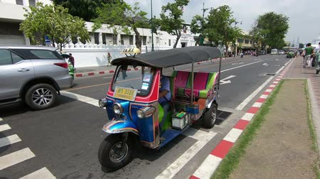 kaew : Bangkok, Thailand - March 6, 2018 : Tuk Tuk is parking in front of Wat Phra Kaeo or Grand Palace, Bangkok, Thailand