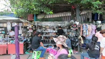 largest city : Bangkok, Thailand - March 11, 2017 : Unidentified people shopping at Chatuchak weekend market open from 8am - 6pm Stock Footage