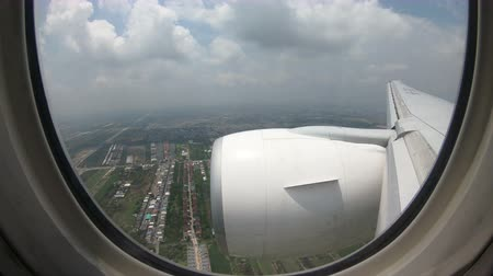 commercial video : 4K Time lapse inflight commercial airplane windows view landing at Suvarnabhumi Airport Stock Footage
