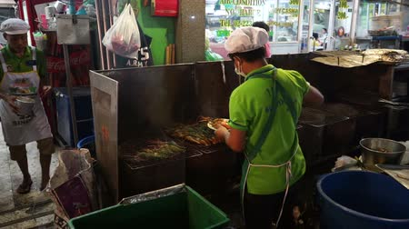 yaowarat road : Bangkok, Thailand - May 3, 2018 : Unidentified chef cooking shrimp at Yaowarat Road in Bangkoks Chinatown district.