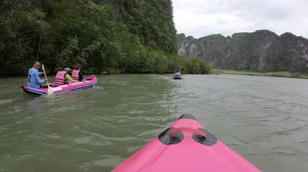 surat : Phuket, Thailand - June 1, 2018 : Tourists in life jackets on kayak boat