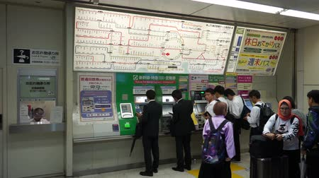 ticket machine : Tokyo, Japan - June 20, 2018 : People buying train tickets at JR Shibuya Station vending machines