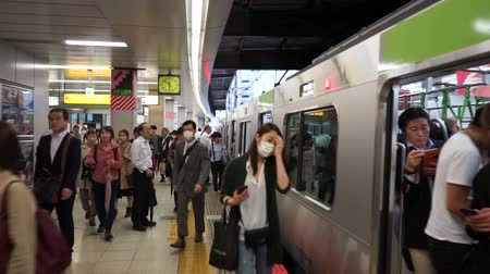 public transportation : Tokyo, Japan - June 20, 2018 : Commuters walking at Shibuya Japan Railway platform