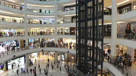 Kuala Lumpur, Malaysia - July 17, 2018 : Time lapse video of interior of Suria KLCC. a modern. luxury shopping mall at the base of the Petronas Towers. in Kuala Lumpur Stok Video