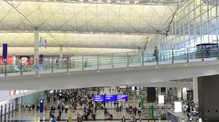 kucak : Hong Kong, China - August 15, 2018 : Time lapse of moving passenger departure and arrival at Hong Kong airport Stok Video