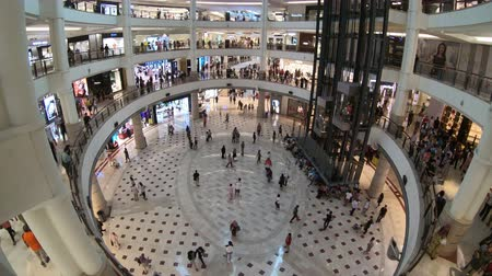 metropolitano : Kuala Lumpur, Malaysia - July 18, 2018 : Time lapse of people are walking and shopping around it and interior at Suria KLCC Stock Footage