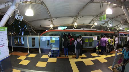 public transportation : Kuala Lumpur, Malaysia - July 18, 2018 : Time lapse of people wait at the Bukit Bintang stop of KL monorail