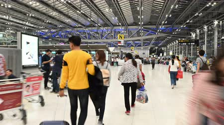 time journey : Bangkok, Thailand - November 23, 2018 : Hyper time lapse of walk through passengers to check-in counter at terminal of Bangkok Suvarnabhumi Airport
