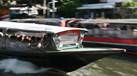 saen : Bangkok, Thailand - December 3, 2018 : The Khlong Saen Saep boat traffic is a water bus operating on the Saen Saep canal in Bangkok Stock Footage