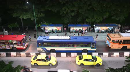 taxi : Bangkok, Thailand - November 21, 2018 : Top view of people waiting bus at bus station on night time