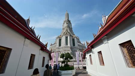 wat : Bangkok, Thailand - December 25, 2018 : Camera moving to central pagoda at Wat Arun