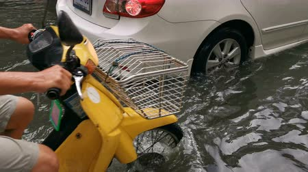 Bangkok, Thailand - June 8, 2019 : Car traffic on the flooded city street during heavy rain