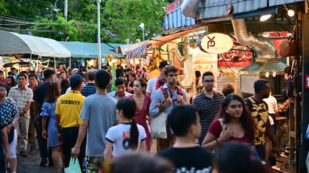 Bangkok, Thailand - June 9, 2019 : People walk, shop, eat, and take photos around the Chatuchak market