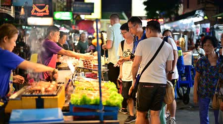 Bangkok, Thailand - June 9, 2019 : Khaosan Road street vendor sell street food with chinese tourist