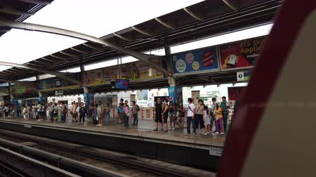 busy line : Bangkok, Thailand - August 11, 2019 : Unidentified crowds of people wait for Bangkok metro BTS skytrain at station