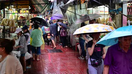 Bangkok, Thailand - September 21, 2019 : People walk around old market at chinatown in rainy day