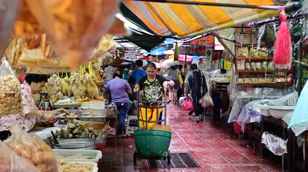 Bangkok, Thailand - September 21, 2019 : Local market at chinatown in rainy day