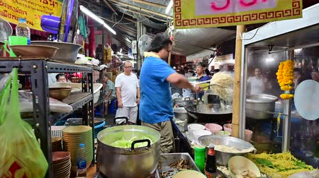 vegetable wok : Bangkok, Thailand - September 29, 2019 : Chef cooking fried noodle at chinese vegetarian festival