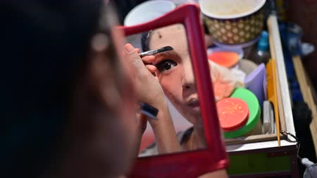 Bangkok, Thailand - October 2, 2019 : Self makeup on mirror behind stage of chinese opera Vídeos
