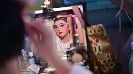 Çin mahallesi : Bangkok, Thailand - October 2, 2019 : Self makeup behind stage of chinese opera