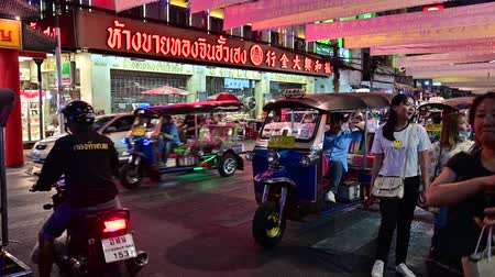 Bangkok, Thailand - December 11, 2019 : Unidentified tourists with traffic is on the road at Chinatown, Bangkok