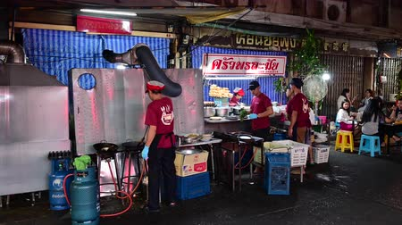 Bangkok, Thailand - December 11, 2019 : Chef preparing food on the street at Yaowarat road