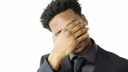 gergin : Afro-american man isolated shot in studio and isolated on a white background Stok Video
