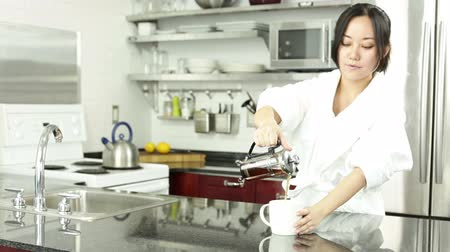kufel : Asian girl in her 30s in her modern kitchen