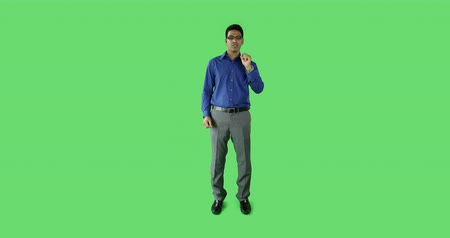ludzik : business man in front of a computer isolated on green screen