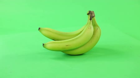 banany : banana on a turn table isolated green screen, seamless loop