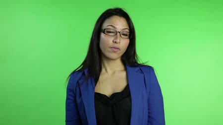 rozhovor : business woman isolated on green screen upset with interview
