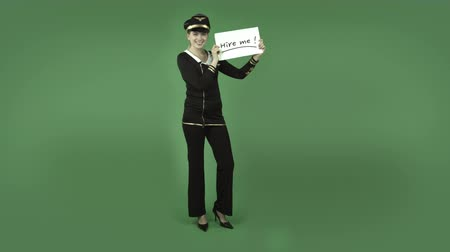 bezrobotny : attractive caucasian air hostess isolated on chroma green background
