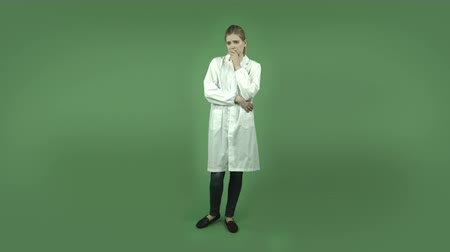 седые волосы : attractive caucasian girl wearing a lab coat isolated on chroma green background
