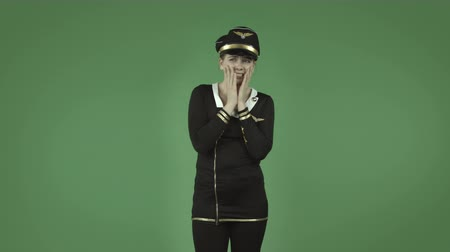 piloto : attractive caucasian air hostess isolated on chroma green background