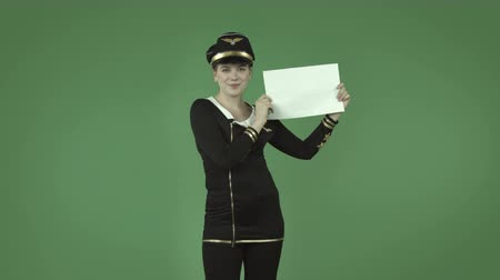 düzlem : attractive caucasian air hostess isolated on chroma green background